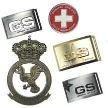 Otros productos como hebillas medallas y trofeos